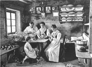 family of wood-carvers at Selva in the Gardena Valley making wooden toys, about 1920